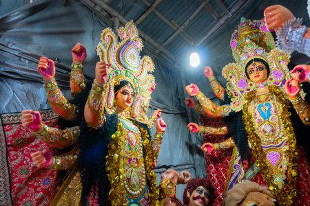 Kolkata, West Bengal, India - 7th October 2018 : Clay idols of Goddess Durga, being prepared for