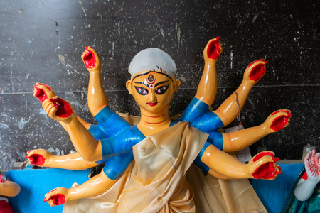 Kolkata, West Bengal, India - 7th October 2018 : Clay idol of Goddess Durga with 10 hands, under preparation for