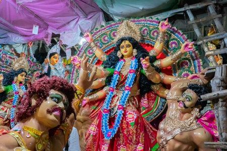 Kolkata, West Bengal, India - 7th October 2018 : Clay idol of Goddess Durga, under preparation for