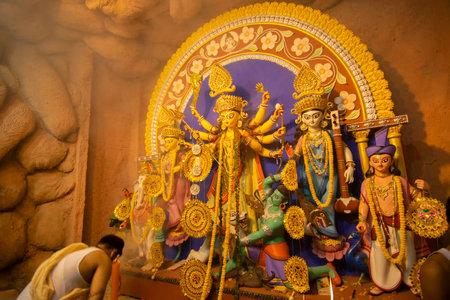 Kolkata , India - October 16, 2018 : Goddess Durga idol inside decorated Durga Puja pandal, shot at colored light . Durga Puja is biggest religious festival of Hinduism.