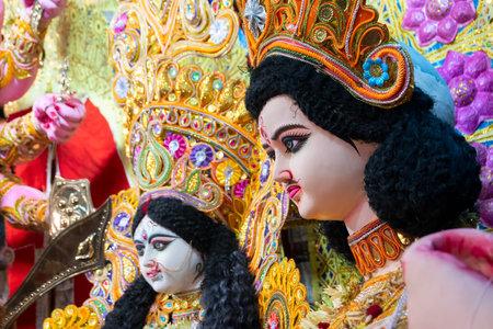 Kolkata, India - October 17, 2018 : Decorated idol of God Kartik and Goddess Saraswati, brother and sister, being worshipped during Durga Puja. Biggest festival of Hinduism, celebrated all over world.