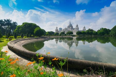 Victoria Memorial, Kolkata , Calcutta, West Bengal, India with blue sky and reflection on water. A Historical Monument of Indian architecture, to commemorate Queen Victoria's 25 years reign in India.