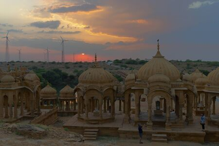 Silhouette of Bada Bagh or Barabagh, with setting sun, is a garden complex in Jaisalmer, Rajasthan, India. A set of royal cenotaphs, or chhatris, of Maharajas of Jaisalmer state. Tourist attraction.