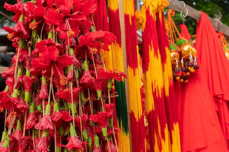 Hinbiscus flowers and worship strings are being sold as worship materials at kalighat, West Bengal, India.