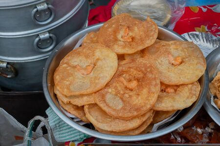 Fusion Puris , Indian puris with Chinese shrimps in it are being sold at Territy Bazarr, Kolkata, West Bengal, India. These are very popular street food in Kolkata.
