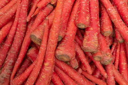 Carrot, Daucus carota , is a root vegetable, usually orange in colour, a domesticated form of the wild carrot. Vegetables for sale in a market in Territy Bazar, Kolkata, West Bengal, India.