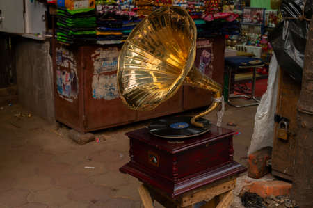 Kolkata, West Bengal, India - 29th December 2019 : Old gramophone of historical age, with his master voice marking on it, for display as antque collection at a retails shop, New Market area, Kolkata.