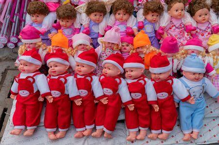 Beautiful cute baby dolls for sale at retail shop at Christmas market, New Market area, Kolkata, West Bengal, India. Banco de Imagens