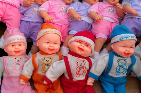 Colourful and happy tiny baby dolls for sale at retail shop at Christmas market, New Market area, Kolkata, West Bengal, India. Banco de Imagens