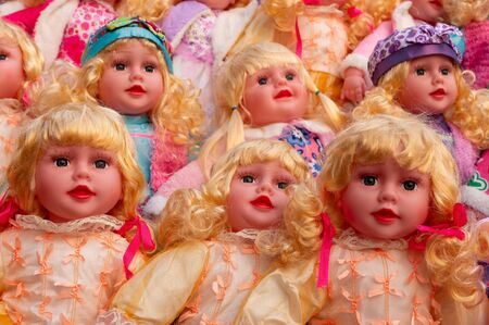 Beautiful cute blonde baby dolls for sale at retail shop at Christmas market, New Market area, Kolkata, West Bengal, India.