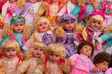 Beautiful cute girl baby dolls for sale at retail shop at Christmas market, New Market area, Kolkata, West Bengal, India.