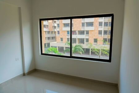 Inside view of window and room of new residential flats being built at Rajarhat New Town area of Kolkata, West Bengal, India. Kolkata is one of the fastest growing city in eastern region of India.