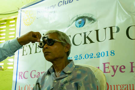 Kolkata, West Bengal, India - 25th February 2018 : Eye sight of Indian male patient is being tested, Eye check up and treatment camp. Sajtókép
