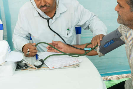 Kolkata, West Bengal, India - 25th February 2018 : Indian Doctor checking blood pressue of a patient with medical instruments.