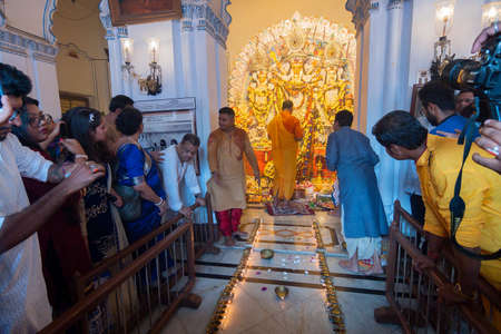 Kolkata, West Bengal, India - 6th October 2019 : 108 lamps are lit , devotees gathered for watching sondhipujo , the sacred ritual at juncture of Ashtami and Nabami, at Shobhabazar Rajbari Durga Puja.