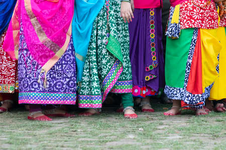Colourful drapes of sari, traditional Indian dress. Young Bengali dancers awaiting their turn to enjoy and dance at Holi festival, celebrated in Kolkata, West Bengal, India.