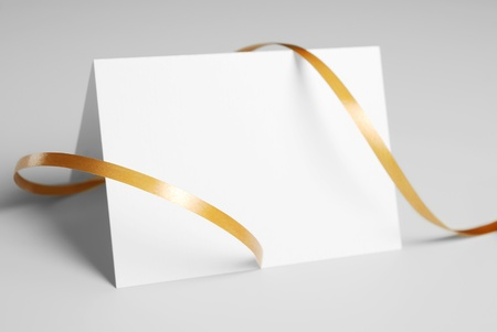 Blank thank you card with golden ribbon