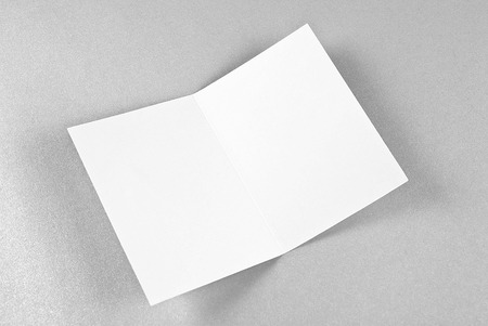 White open card over silver background