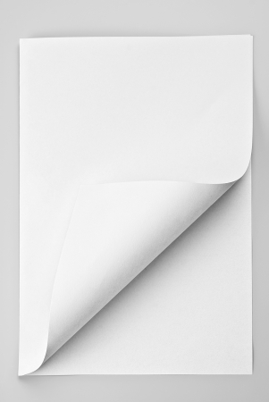 folded paper: Folded sheet of paper with curled corner