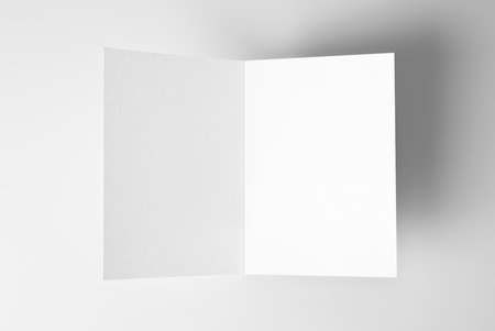 Blank open card over grey background with shadow
