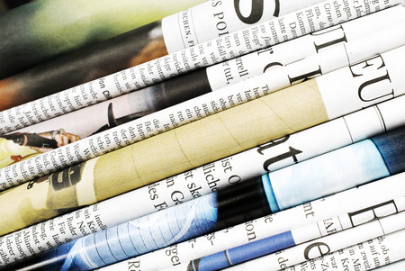Close-up of folded newspapers photo