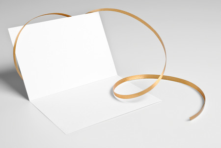 Blank open card with golden ribbon
