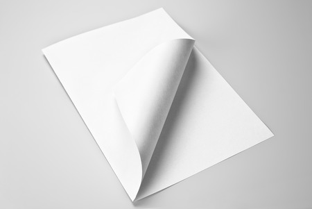 turns of the year: Blank folded sheet of paper with curled corner Stock Photo