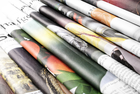 print media: Folded newspapers background Stock Photo