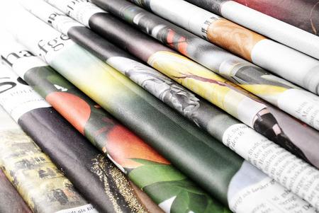 Folded newspapers background Standard-Bild