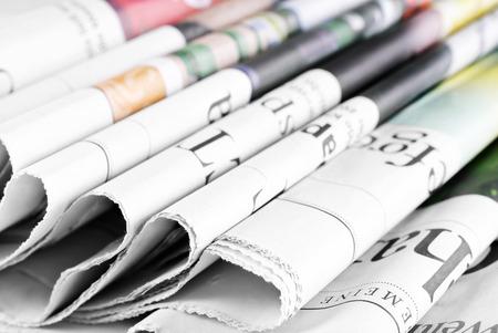 Heap of old folded newspapers Foto de archivo