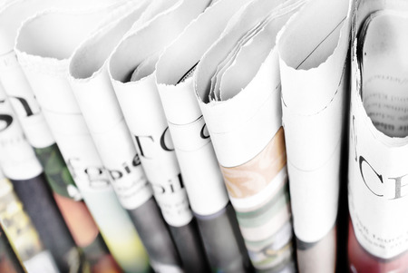 folded paper: Folded newspapers standing Stock Photo