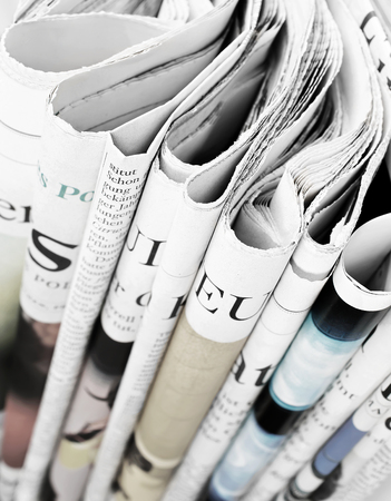 print media: Pile of newspapers, selective focus Stock Photo