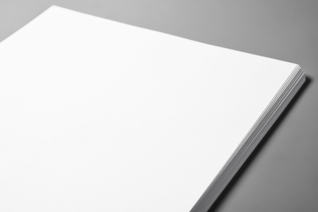 Pile of blank sheets of paper over gray background