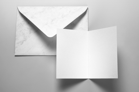 Blank card and envelope over gray background with shadow Stock Photo