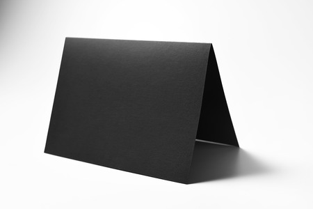 Blank black card over gray background with shadows Stock Photo