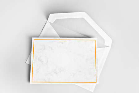 Blank card with yellow frame and envelope Stock Photo