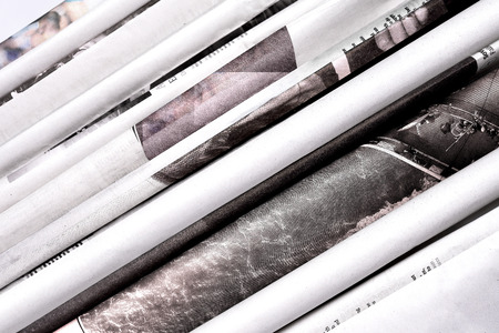 Folded newspapers background. Copy space