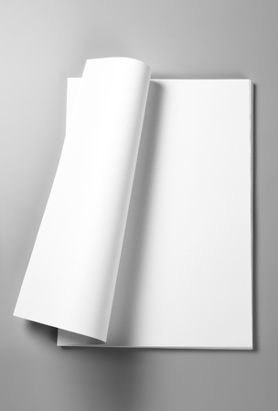 Pile of blank sheets of paper with curled upper page