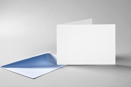 Blank folded standing card and envelope