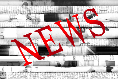 Diagonal word News written with red letters over newspaper background