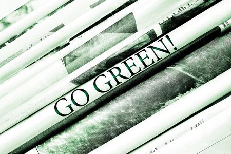 Headline ? ? ?Go green! ? ? overlied newspapers background