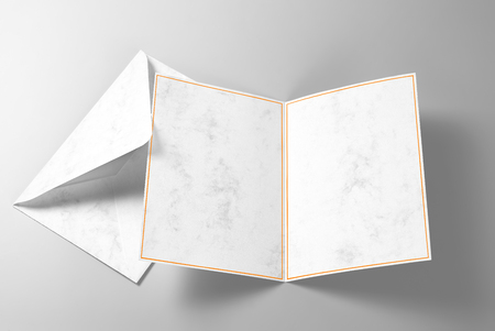 Blank greeting or invitation card with gold frame and envelope