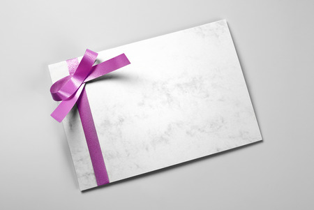 Blank thank you card decorated with violet ribbon Stock Photo