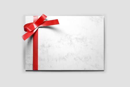Blank greeting or thank you card decorated with red ribbon Stock Photo