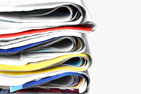 Old folded newspapers. Selective focus. Stock Photo