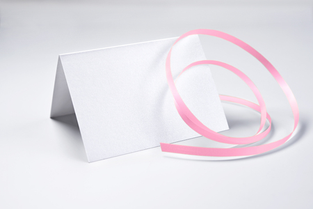 Blank thank you card decorated with rose ribbon