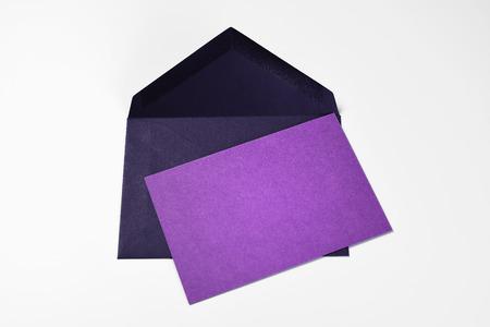 Blank violet greeting card and dark blue envelope