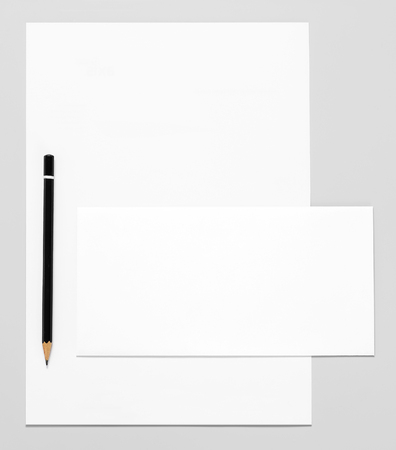 Blank stationery: paper, envelope, and pencil Stock Photo