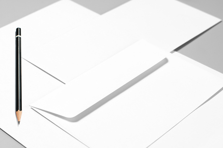 Blank stationery: sheets of paper, pencil, and two envelopes