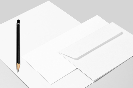 Blank stationery: sheet of paper, pencil, and two envelopes